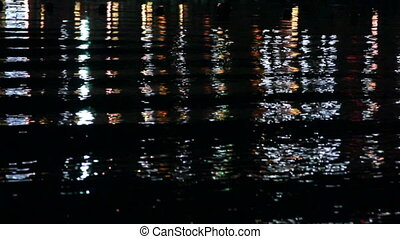 Light reflection on water at night