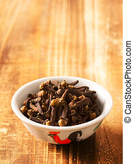close up of cloves in a bowl