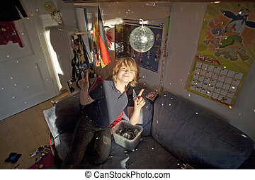 boy with mirror ball in his nursery surrounded by his toys
