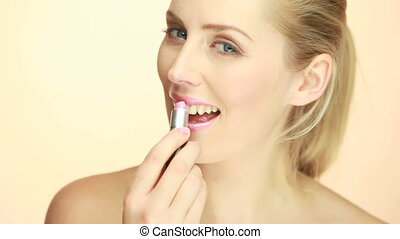 Smiling Glamorous Lady Applying Lipstick
