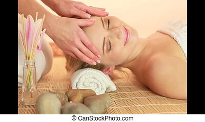 Head Massage In Spa, female hands massaging the forehead and...
