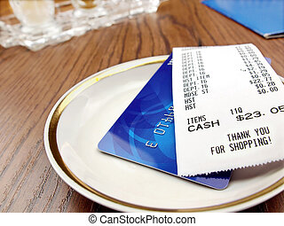 Paying Bill  - Receipt and credit card.
