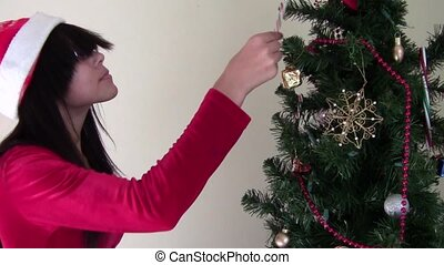 Eating Candy Cane - Girl removing and eating candy cane from...