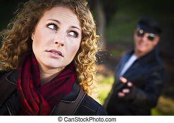 Pretty Young Teen Girl with Man Lurking Behind Her