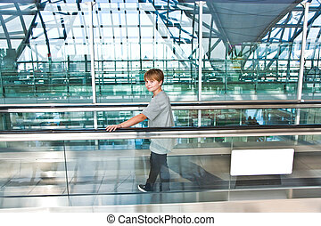 boy in the departure hall in the new Airport Suvarnabhumi in...