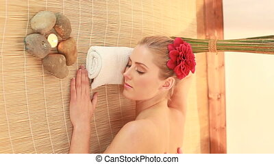 spa and massage - blonde woman relaxing having spa and...