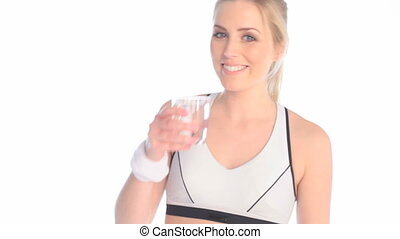 Tired Athlete Drinking Fresh Water from a glass, upper body...