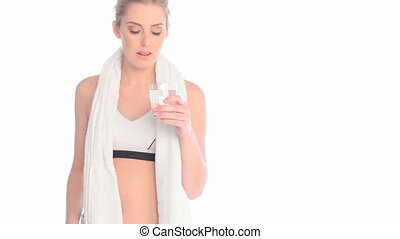Lady Drinking Water After Workout