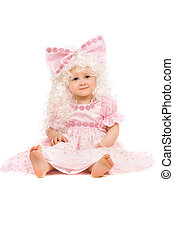 Baby girl in a pink dress. Isolated
