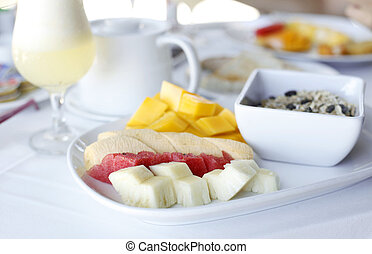 healhty breakfast with assortment of fresh fruits, cereal...
