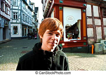 cute boy likes to visit the old city of limburg
