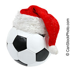 Santa Claus hat on the soccer ball on the white background....