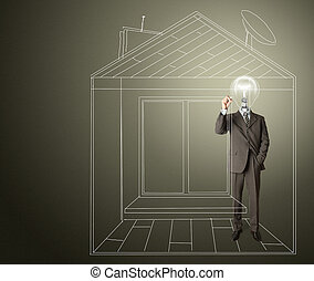 businessman with lamp-head and marker in house - businessman...