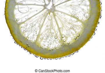 lemon in the water - slice of lemon in the water with...