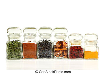 Food additives - Glass jars with colorful herbs and spices....