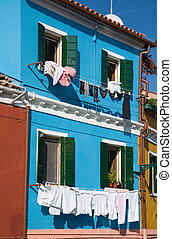 Burano island in lagoon of Venice; famous brightly-colored...