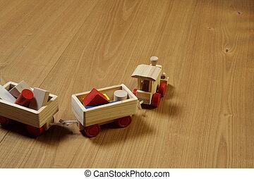 woodden train toy on parquet.