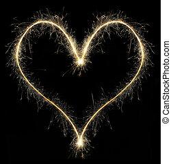 heart from Christmas sparkler on black background