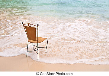 Chair on an exotic beach - Lonely Chair standing on an...