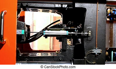 pan on plastic press molding machine during work - pan on...