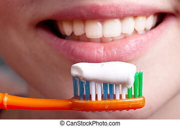 Toothpaste - Toothbrush, toothpaste and smiling woman