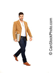 man walking with a laptop - wolking business man holds a...