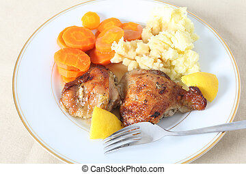 Lemon chicken meal on plate - A high angle view of chicken...