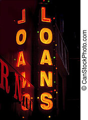 Neon Loans - A neon loans sign at night in Manhattan.