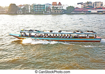 transportation on the river in Bangkok in sunrise in a ferry...