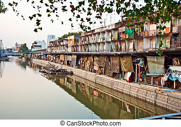 houses along a canal in Bangkok