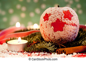 Red delicious Christmas apples with candle