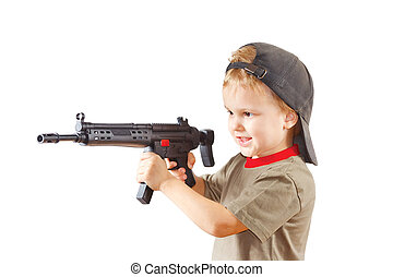 Little boy plays with gun on a white background