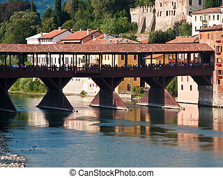 the old wooden bridge spans the river brenta at the romantic...