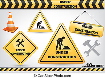 collection of under construction signs