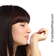Young woman smelling perfume on wrist isolated on white...