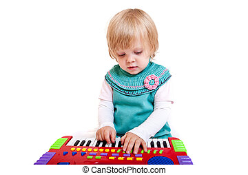 Little girl - Portrait of cute little girl with toy piano....