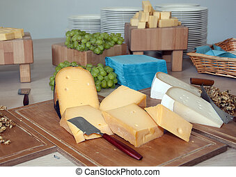 Cheese selection on woodboard