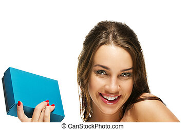 happy young woman holding present box on white background