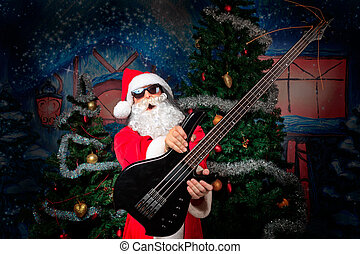 guitarist santa - Portrait of a singing Santa Claus with...