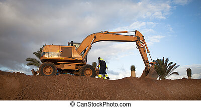 excavator works on construction of new road