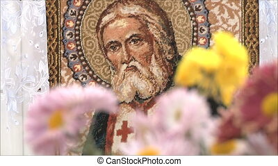 icon of the saint, the focus turns to flowers