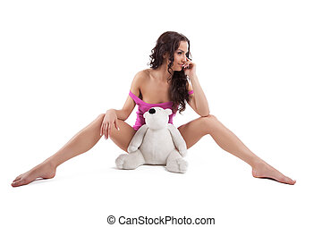 Young sexy woman in purple shirt with white bear