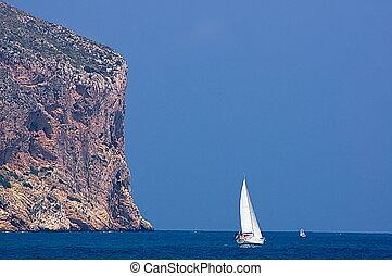 The Cape - Cape over sailboat over Mediterannean sea.
