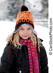 Portrait of Dutch girl in wintertime looking into camera