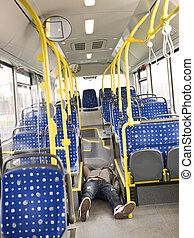 Lieing on the bus - Young man lieing on the floor on the bus