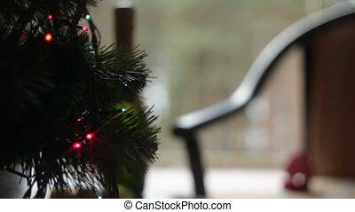 Christmas tree. Changing lights.