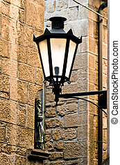 Glowing Wrought Iron Lamp, in traditional lantern shape...