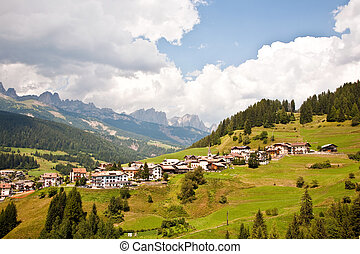 view over the meadows and agriculture in the dolomite alpes,...