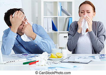 Sick companions - Image of sick business partners blowing...