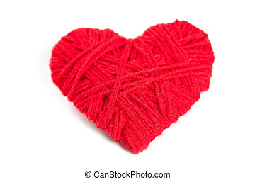 red thread heart isolated on white background